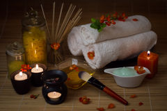 Close-up. Spa still life. Sea salt bath, massage oil, candles, flowers and towels. Stock Image