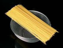 Close up of spaghetti. Over a colander Royalty Free Stock Photography