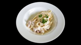 Close-up spaghetti carbonara bacon with clipping part isolated on black background royalty free stock images