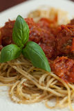 Close up of spaghetti and meatballs with basil leaf Royalty Free Stock Image