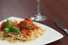 Close up of spaghetti and meatballs with red wine Royalty Free Stock Photo