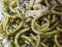 Close up of Spaghetti Pesto. Spaghetti Pesto alla Genovese topped with Parmesan cheese close up Stock Image