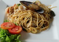 Close up of Spaghetti with shrimp, squid , mussels and vegetable Royalty Free Stock Image