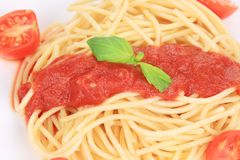 Close up of spaghetti with tomato sauce and basil Royalty Free Stock Images