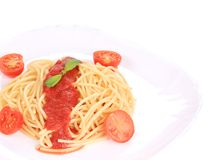 Close up of spaghetti with tomato sauce and basil Royalty Free Stock Photo