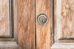 Old wooden door and lock in spain royalty free stock image