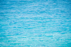 Close up of sparkling blue water with wave surface in swimming pool. Selective Focus Royalty Free Stock Photography