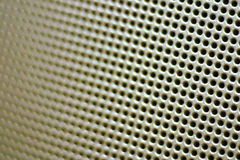 Close-up Speaker Grille. A close up shot of a speaker grille with narrow depth of field Stock Image
