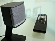Close up of speaker and TV remote Royalty Free Stock Images