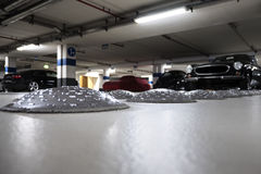 Close-up of speed bumps in a parking garage. Selective focus stock photo
