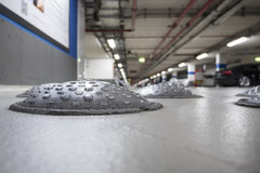 Close-up of speed bumps in a parking garage. Selective focus stock photography