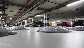 Close-up of speed bumps in a parking garage. Selective focus stock image