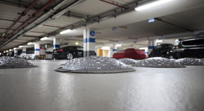 Close-up of speed bumps in a parking garage. Selective focus stock photos