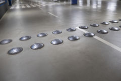 Close-up of speed bumps in a parking garage. Selective focus royalty free stock photo