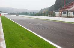 Close up of speedway track or road and stands. Motosports, extreme and race concept - close up of speedway track or road and stands stock photo