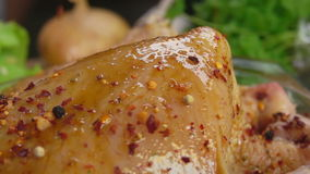 Close-up of spices on the chicken falls stock video footage