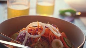 Close up of spicy green papaya salad of Thai cuisine. Thai people call it SOM TAM. Slow motion. 1920x1080 stock footage