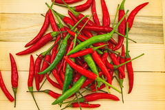 Close up spicy hot peppers green and red in a wooden box Royalty Free Stock Photos