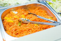 Close up of spicy korean carrot salad in container Royalty Free Stock Photography
