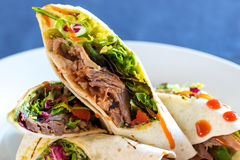 Close up of spicy mexican meat wrap. Stock Image