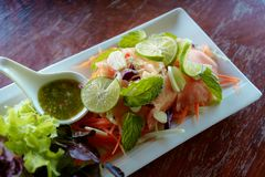 Close up spicy salmon salad in the white dish royalty free stock images
