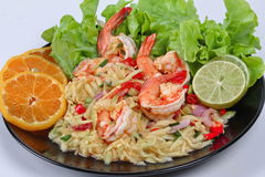 Close up spicy sour minced green mango salad with shrimp. Selective focus. Royalty Free Stock Photo