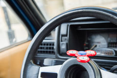 Close-up Spinner-Fidget is a toy for shunting time being in the car in standing in an automotive traffic jam Stock Photo