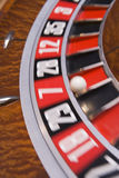 Close up of spinning roulette wheel. With ball in number seven Stock Photography