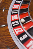 Close up of spinning roulette wheel. With ball in number thirteen Stock Image