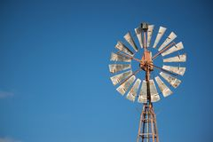 Close up Spinning Windmill on summer day royalty free stock image