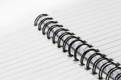 Close up of a spiral bound notebook with black spirals Stock Photo