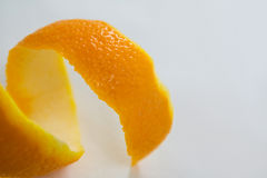 Close-up of spiral orange peel. On white background royalty free stock photos