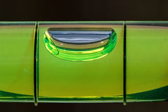 Close up of a spirit level. Showing horizontal bubble against a dark background Stock Images