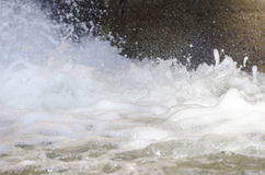 Close up of splash of water forming foam shapes. Natural environment Royalty Free Stock Image