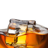 Close up splash of whiskey with ice Royalty Free Stock Images