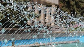 Splashes of water of a city fountain. Close-up splashes of water of a city fountain stock video