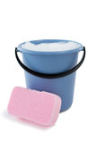 Close up of sponge by bucket containing soap sud Royalty Free Stock Photography