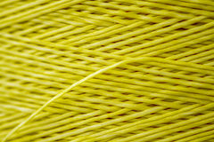 Close up of a Spool of Synthetic Green Thread Royalty Free Stock Photo