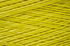 Close up of a Spool of Synthetic Green Thread Royalty Free Stock Images