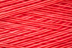Close up of a Spool of Synthetic Pink Thread Royalty Free Stock Photo