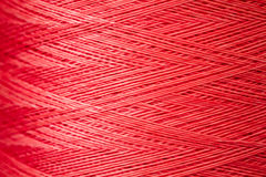 Close up of a Spool of Synthetic Pink Thread Royalty Free Stock Image
