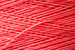 Close up of a Spool of Synthetic Pink Thread Stock Image