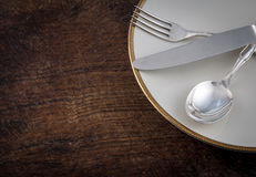Close up Spoon, Fork and Knife Tied on White Dish with Empty Tag Stock Photography