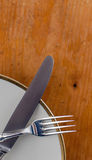 Close up Spoon, Fork and Knife Tied on White Dish with Empty Tag Stock Images