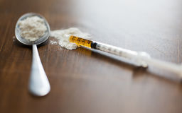 Close up of spoon and syringe with drug dose. Drug use, crime, addiction and substance abuse concept - close up of spoon and syringe with crack cocaine drug dose Stock Photos