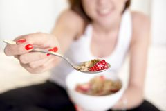 Close up spoon woman eating cereal strawberries Royalty Free Stock Photos
