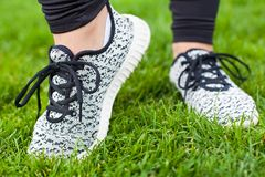Sportive female training shoes Royalty Free Stock Photos