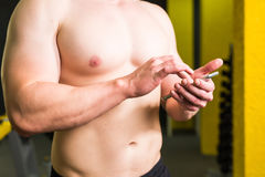 Close-up of Sportive Man After Workout Session Checks Fitness Results Smartphone. Adult Guy Wearing Sport Tracker Royalty Free Stock Images