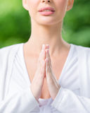 Close up of sportive woman prayer gesturing Stock Image