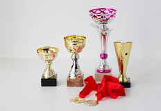 Close up of sports golden cups and medals Stock Photo